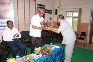 Dr.P.B.Jaju-Welcoming-Shri-Prakash-Chapre-Legal-Advisor-ZP-Vijayapur.s.jpg